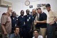David Trotman-Wilkins, (center/back row), makes peace still can smile after being forced by Liberian police to erase two photographs he took of the new U.S. Embassy in Monrovia.